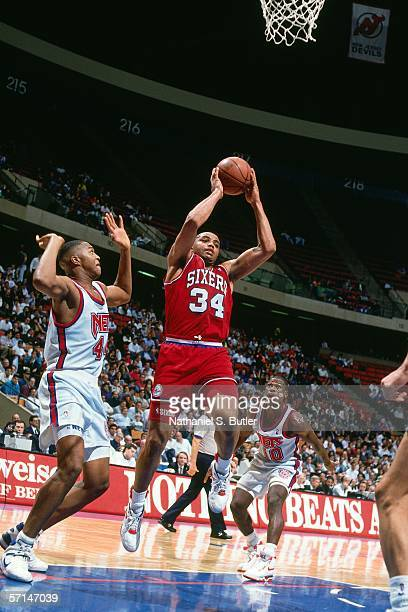 Charles Barkley of the Philadelphia 76ers grabs a rebounds against the New Jersey Nets during an NBA game in 1990 at the Brendan Byrne Arena in East...