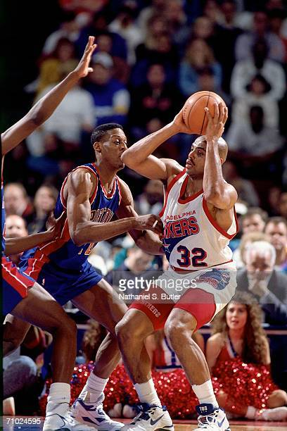 Charles Barkley of the Philadelphia 76ers looks to shoot against Dennis Rodman of the Detroit Pistons during a game circa 1992 at the Spectrum in...