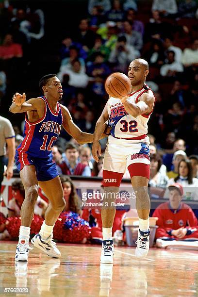 Charles Barkley of the Philadelphia 76ers passes against Dennis Rodman of the Detroit Pistons during a game played in 1991 at the Spectrum in...