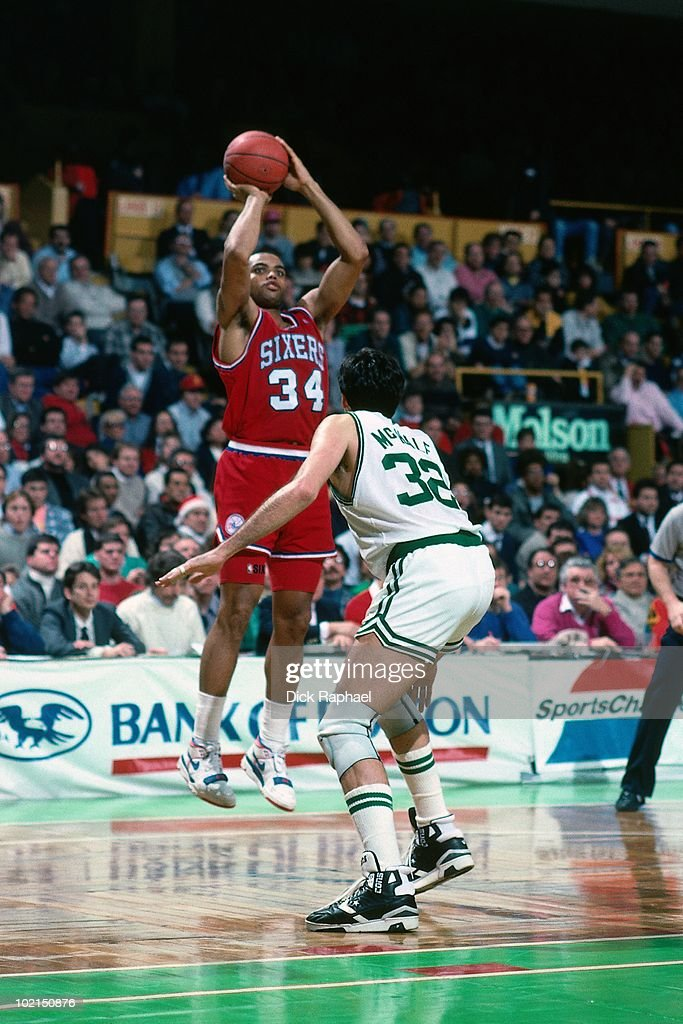 Charles Barkley #34 of the Philadelphia 76ers shoots a jump shot against Kevin McHale #32 of the Boston Celtics during a game played in 1990 at the Boston Garden in Boston, Massachusetts.