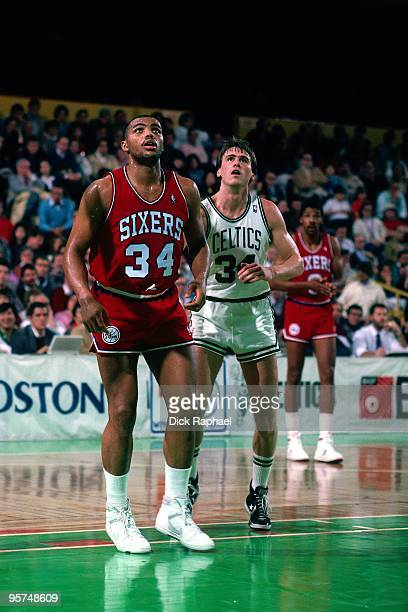 Charles Barkley of the Philadelphia 76ers stands with Rick Carlisle of the Boston Celtics during a game played in 1987 at the Boston Garden in Boston...