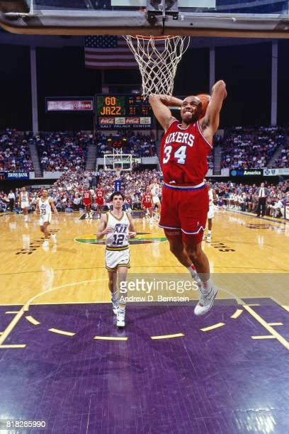 Charles Barkley of the Philadelphia Sixers dunks against the Utah Jazz during a game at the Delta Center in Salt Lake City Utah circa 1990 NOTE TO...