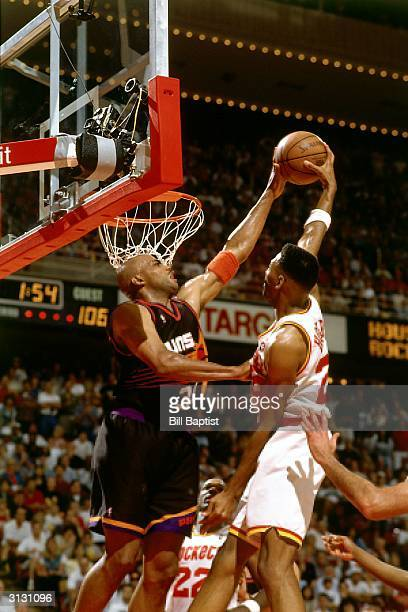 Charles Barkley of the Phoenix Suns blocks a shot by the Houston Rockets circa 1995 during the NBA game in Houston Texas NOTE TO USER User expressly...