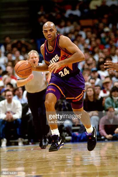 Charles Barkley of the Phoenix Suns dribbles up court against the New Jersey Nets during an NBA game at Brendan Byrne Arena in 1993 in East...