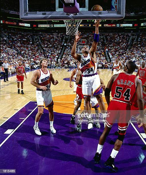 Charles Barkley of the Phoenix Suns drives to the basket for a layup against the Chicago Bulls in Game Two of the 1993 NBA Championship Finals at...
