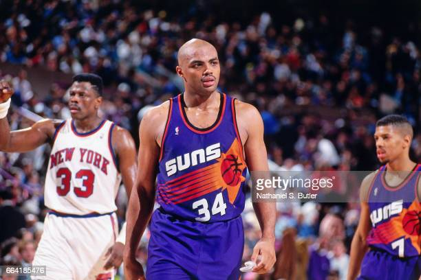 Charles Barkley of the Phoenix Suns looks on against the New York Knicks during a game played circa 1993 at the Madison Square Garden in New York...