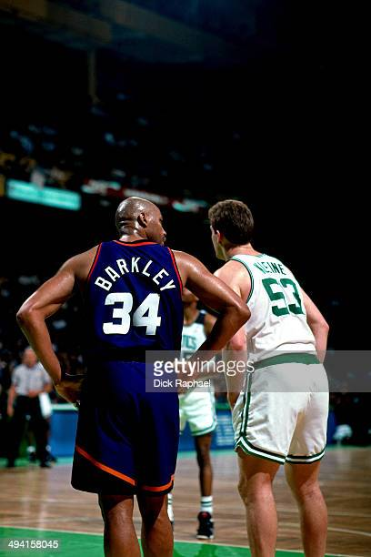 Charles Barkley of the Phoenix Suns shares a word with Joe Kleine of the Boston Celtics during a game played at the Boston Garden in Boston...
