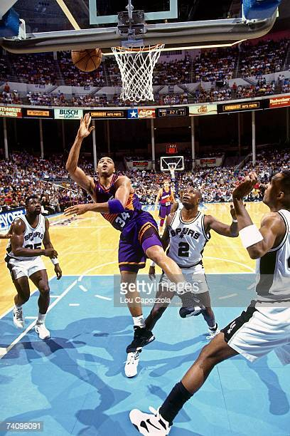 Charles Barkley of the Phoenix Suns shoots a layup against Lloyd Daniels of the San Antonio Spurs during Game Three of the Western Conference...