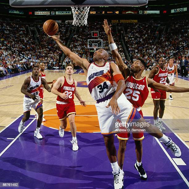 Charles Barkley of the Phoenix Suns shoots a layup against Robert Horry of the Houston Rockets in Game Five of the Western Conference Semifinals...