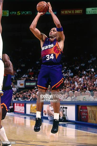 Charles Barkley of the Phoenix Suns shoots the ball against the Golden State Warriors circa 1995 at the OaklandAlameda County Coliseum Arena in...