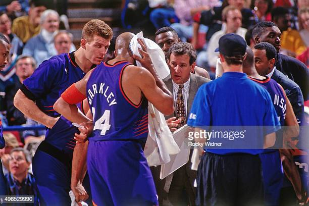 Charles Barkley of the Phoenix Suns stands in the huddle against the Sacramento Kings circa 1993 at Arco Arena in Sacramento California NOTE TO USER...