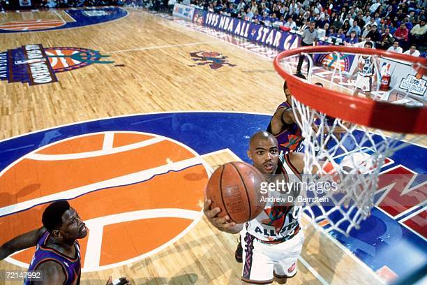 Charles Barkley of the Western Conference All-Stars attempts a layup against Patrick Ewing of the Eastern Conference All-Stars during the 1995 NBA...