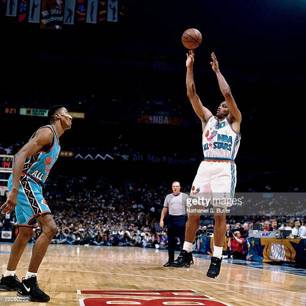 Charles Barkley of the Western Conference AllStars shoots a jump shot over Scottie Pippen of the Eastern Conference AllStars during the 1996 NBA...
