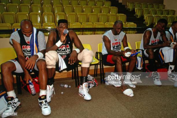 Charles Barkley Patrick Ewing Michael Jordan and David Robinson of the United States National Team take a rest on the sideline during practice in...