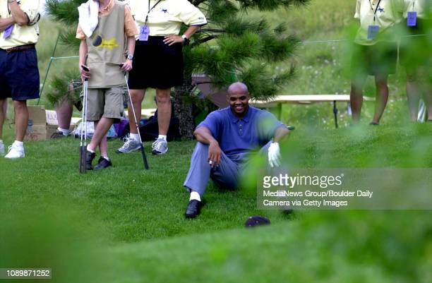 Charles Barkley takes a breather while watching his competitors play the 18th hole of the Sun Microsystems John Elway Celebrity Classic