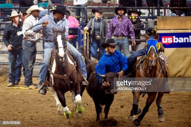 Charles Barrett competes in the Men's Bull Dogging competition during the MLK Jr African American Heritage Rodeo at the National Western Stock Show...