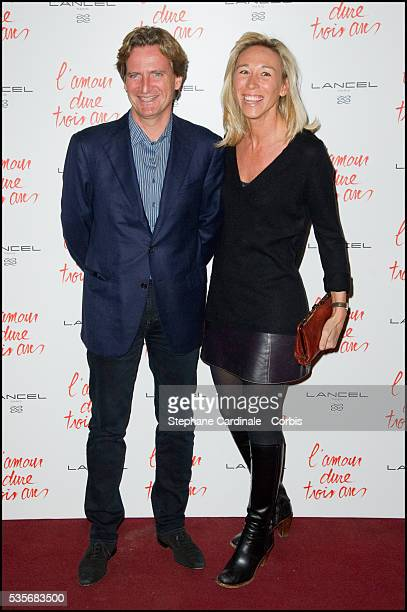 Charles Beigbeder and his wife Carine attend the premiere of L'Amour Dure Trois Ans at Le Grand Rex in Paris