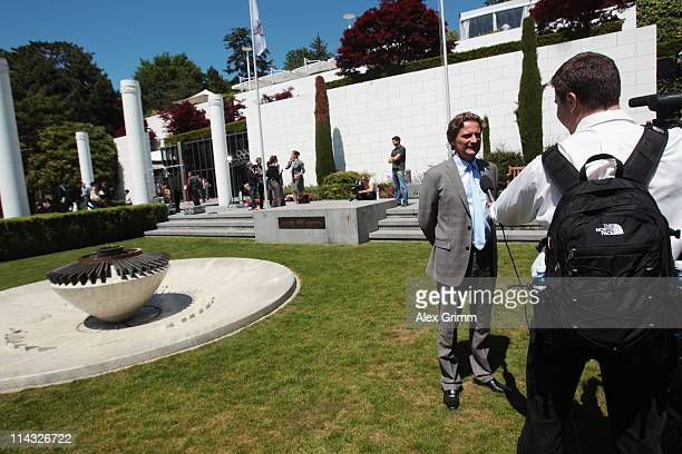 Charles Beigbeder President of the Annecy 2018 bid committee anwers reporters' questions during the briefing for IOC members at the Olympic Museum on...
