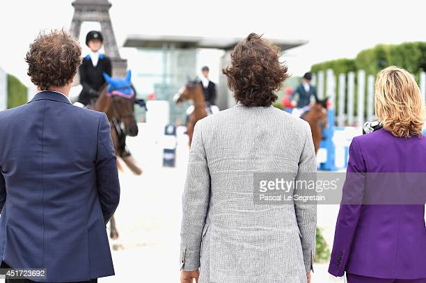 Charles Berling Richard Orlinski and Virginie CouperieEiffel attend the Paris Eiffel Jumping presented by Gucci at ChampdeMars on July 5 2014 in...