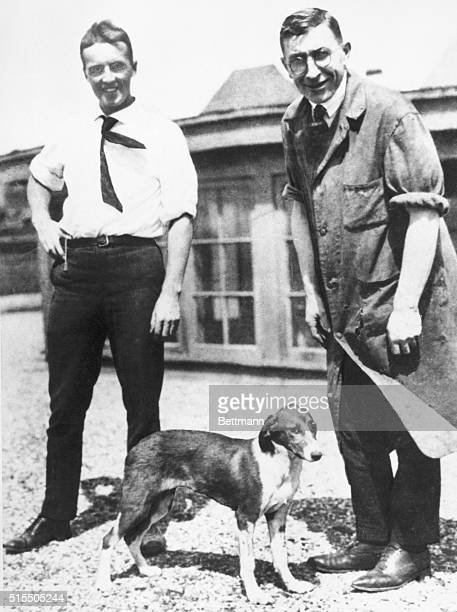 Charles Best and Frederick G Banting on roof of Medical Building University of Toronto with the first dog to be kept alive by insulin Summer of 1921