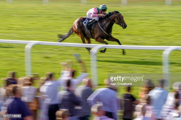 Charles Bishop riding Lively Lydia win The Frimley Health Charity Maiden Auction Fillies' Stakes at Windsor Racecourse on August 6 2018 in Windsor...