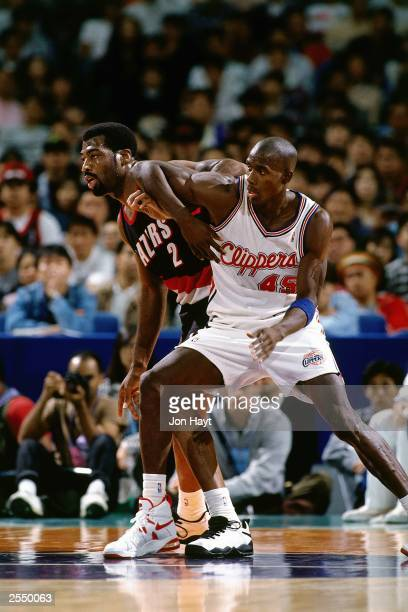 Charles Bo Outlaw of the Los Angeles Clippers battle for position against mark Bryant of the Portland Trail Blazers during the 1994 Japan Games at...