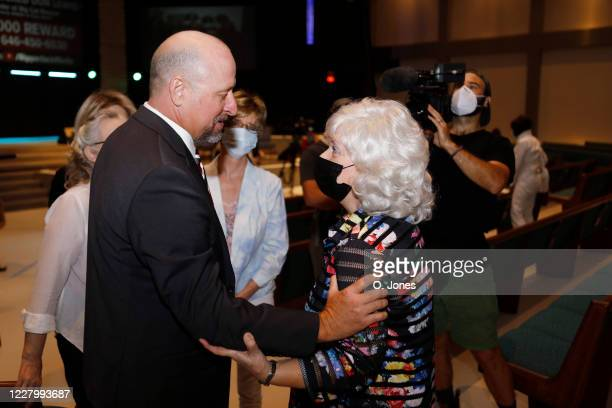 Charles Boswell talks with Gladys Cross the exwife of of Don Lewis after giving a news conference at Riverhills Church of God on August 10 2020 in...