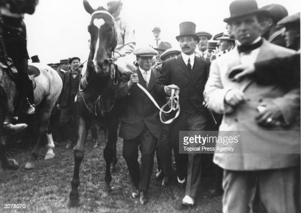 Charles Bower Ismay leading in his racehorse Craganour at the Epsom Derby, 4th June 1913.