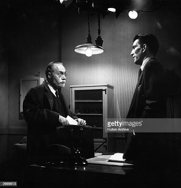 Charles Boyer and Michael Rennie in the film 'The Thirteenth Letter' directed by Otto Preminger and produced by 20th Century Fox