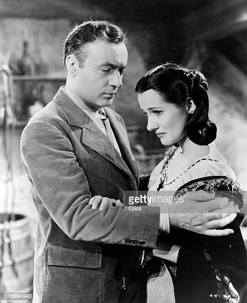 Charles Boyer who plays Lewis Dodd in a clinch with Brenda Marshall who plays Toni Sanger in a scene from the romantic drama 'The Constant Nymph'...