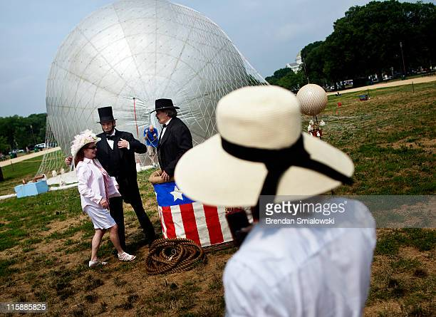Charles Brady an Abraham Lincoln portrayer and Kevin Knapp a Thaddeus Lowe portrayer pose with people in a balloon basket during a balloon...