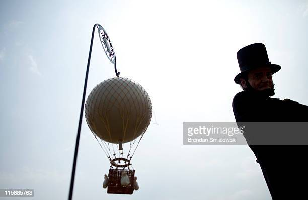 Charles Brady an Abraham Lincoln portrayer walks past a model of an American Civil Warera observation balloon during a balloon demonstration on the...