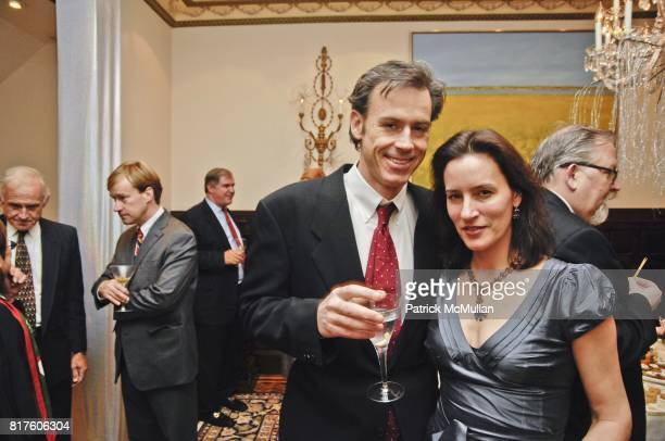 Charles Brainerd and Amanda Brainerd attend NEW YORK CITY OPERA AN EVENING OF HOLIDAY CHEER Hosted by Roy Niederhoffer and Jenny Lebowitz at Private...