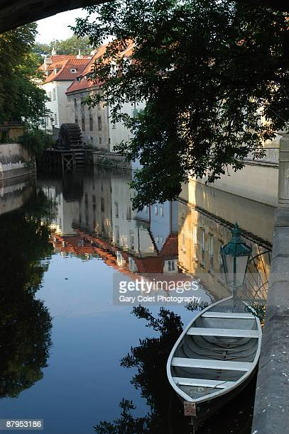 charles bridge and boat, vltava, prague - gary colet stock pictures, royalty-free photos & images