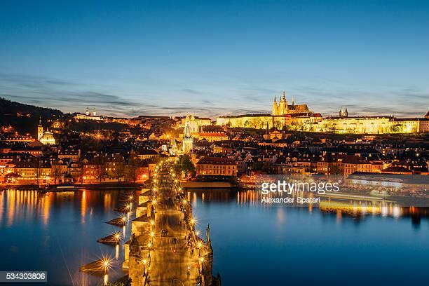 Charles Bridge and Prague illuminated skyline after the sunset, Prague, Czech Republic