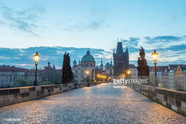 charles bridge at dusk,prague - hradcany castle stock pictures, royalty-free photos & images