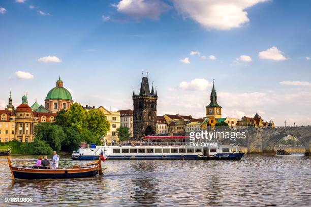 charles bridge, boat cruise on vltava river. prague. czech republic - vltava river stock pictures, royalty-free photos & images