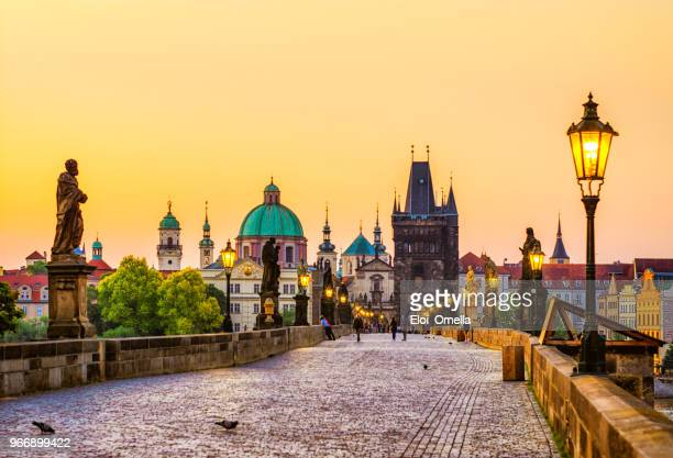 charles bridge (karluv most) in prague at golden hour. czech republic - charles bridge stock photos and pictures