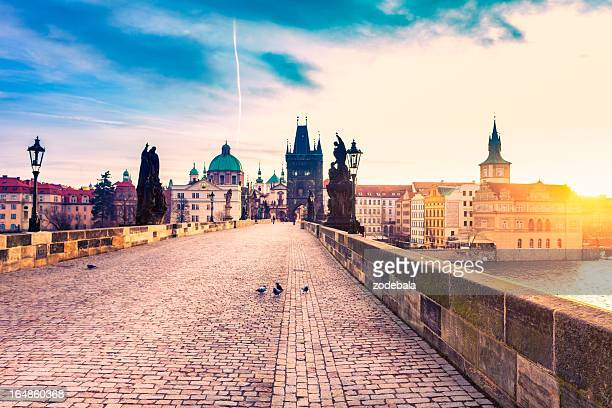 charles bridge in prague at sunrise - charles bridge stock photos and pictures