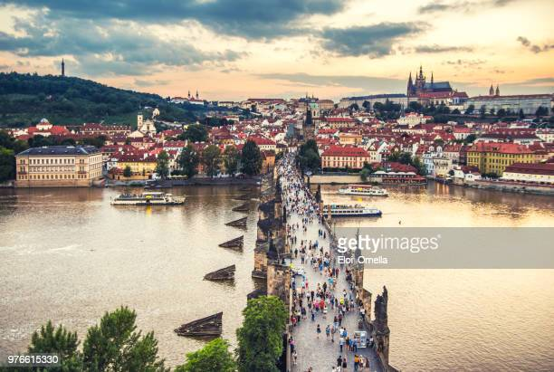 charles bridge in prague at sunset. czech republic - prague stock pictures, royalty-free photos & images