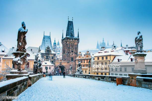 charles bridge in winter, prague, czech republic - prague stock pictures, royalty-free photos & images