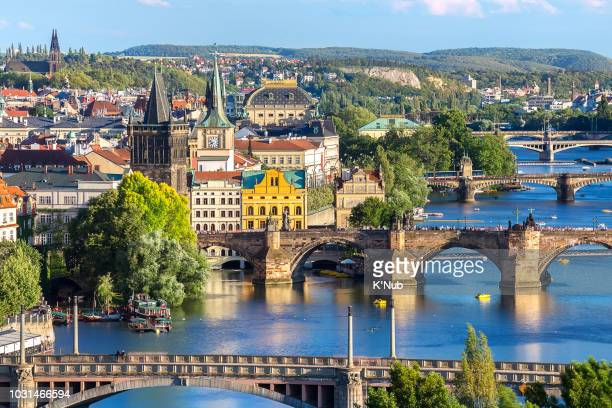 charles bridge, landmark for people who want to travel, and layer of bridge over the river and prague old town from aerial or top view at prague, czech republic, europe - vltava river stock photos and pictures