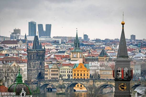 charles bridge, old town bridge tower, clock towers and vltava river, prague - vltava river stock photos and pictures