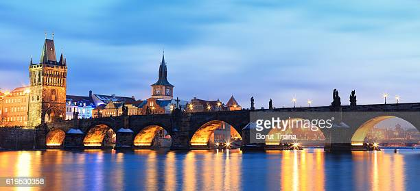 charles bridge panoramic - charles bridge stock photos and pictures
