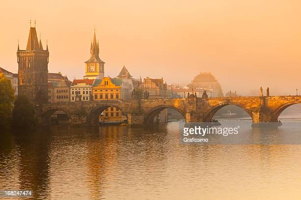 charles bridge prague czech republic at golden dawn - charles bridge stock photos and pictures
