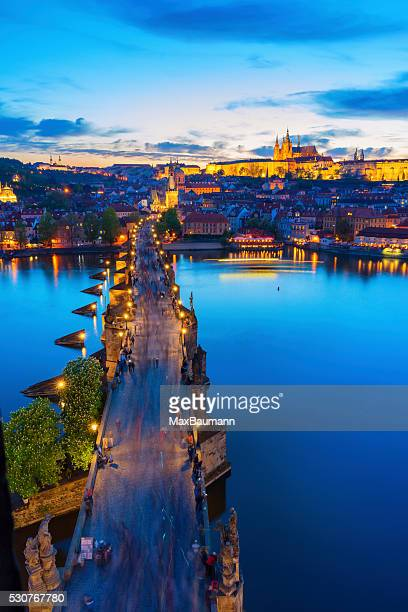 charles bridge prague in the evening light - charles bridge stock photos and pictures