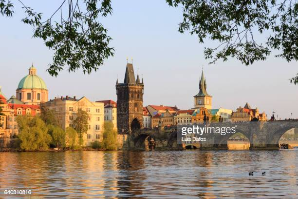 charles bridge, stare mesto and vltava river. prague - charles bridge stock photos and pictures