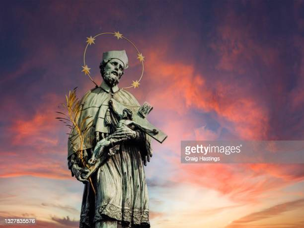 charles bridge statue during sunset, capital city of the czech republic, is bisected by the vltava river. europe eu - statue stock pictures, royalty-free photos & images