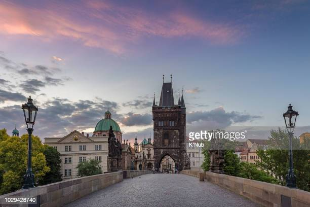 charles bridge with old town bridge tower with beautiful sunset or sunrise sky in prague at czech republic, europe - vltava river stock photos and pictures