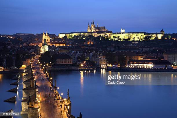 Charles Bridge with Prague Castle and Saint Vitus Cathedral in the background, dusk, Prague, Czech Republic